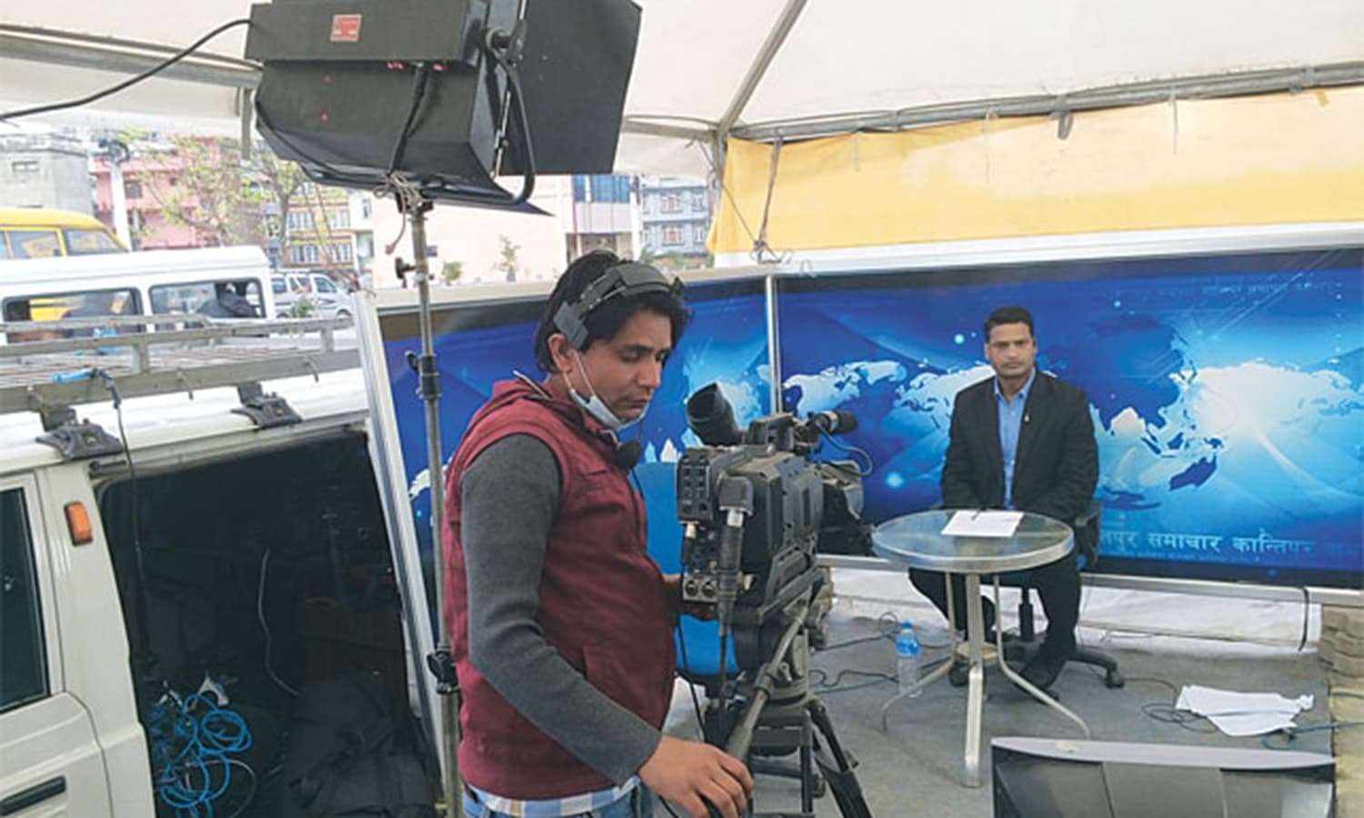 With their offices damaged, the editors and staffers of Kantipur TV continued to broadcast 16 hours of live news from a makeshift office on the street
