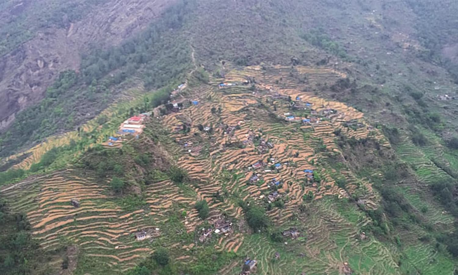Villages were the hardest hit, with the military estimating that 60 to 99 per cent of village construction damaged or destroyed by the quake in the outer districts. This is a damaged hamlet just north of Lambagar in the northeast, close to the epicentre of the earthquake. Already remote, it was completely cut off from the rest of the county before the chopper flights started.