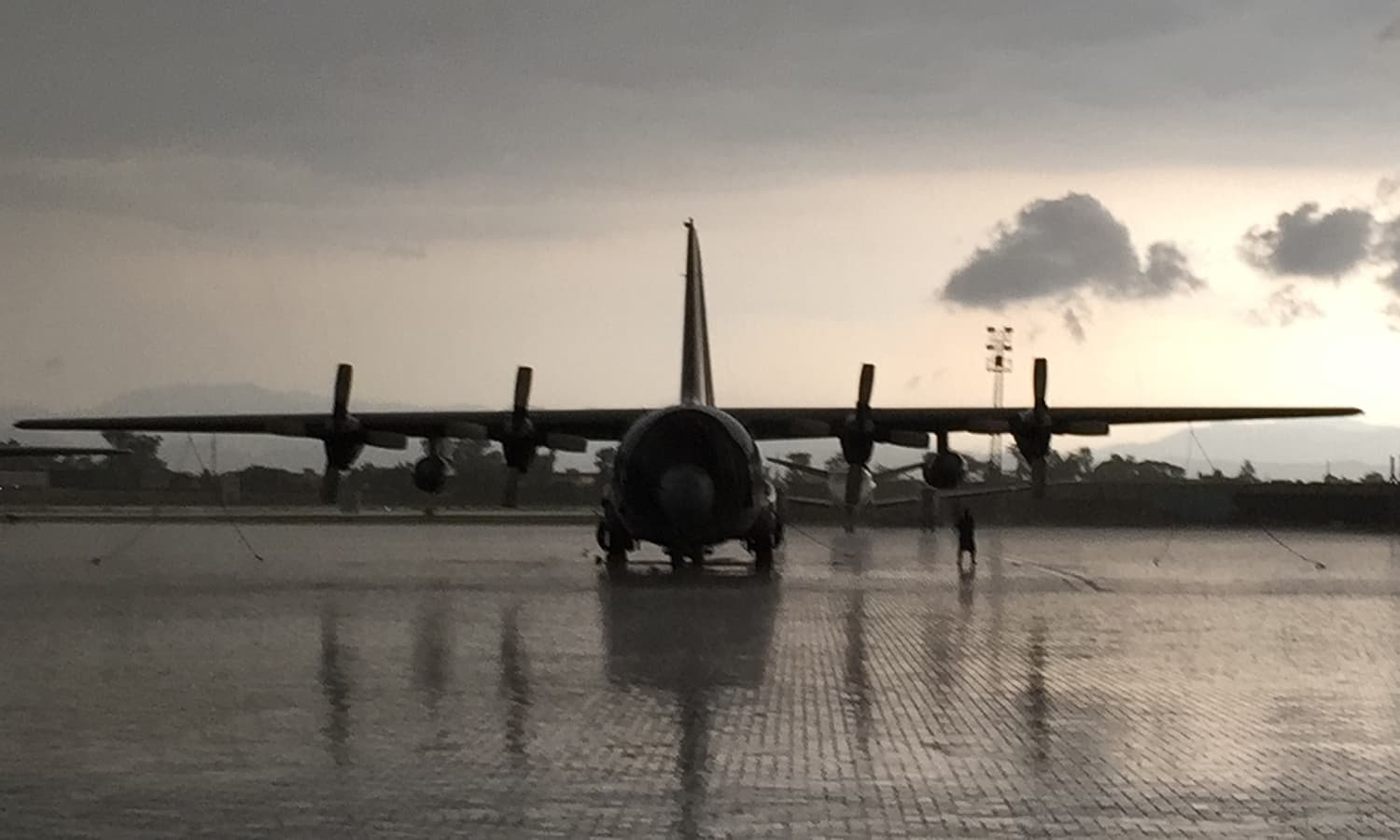 The journey begins; after a 18-hour wait on the tarmac of the Nur Khan Airbase, the Pakistan Air Force C-130E Hercules, loaded with relief supplies and a search and rescue team of the Army's 13th Engineers, takes off for Kathmandu.
