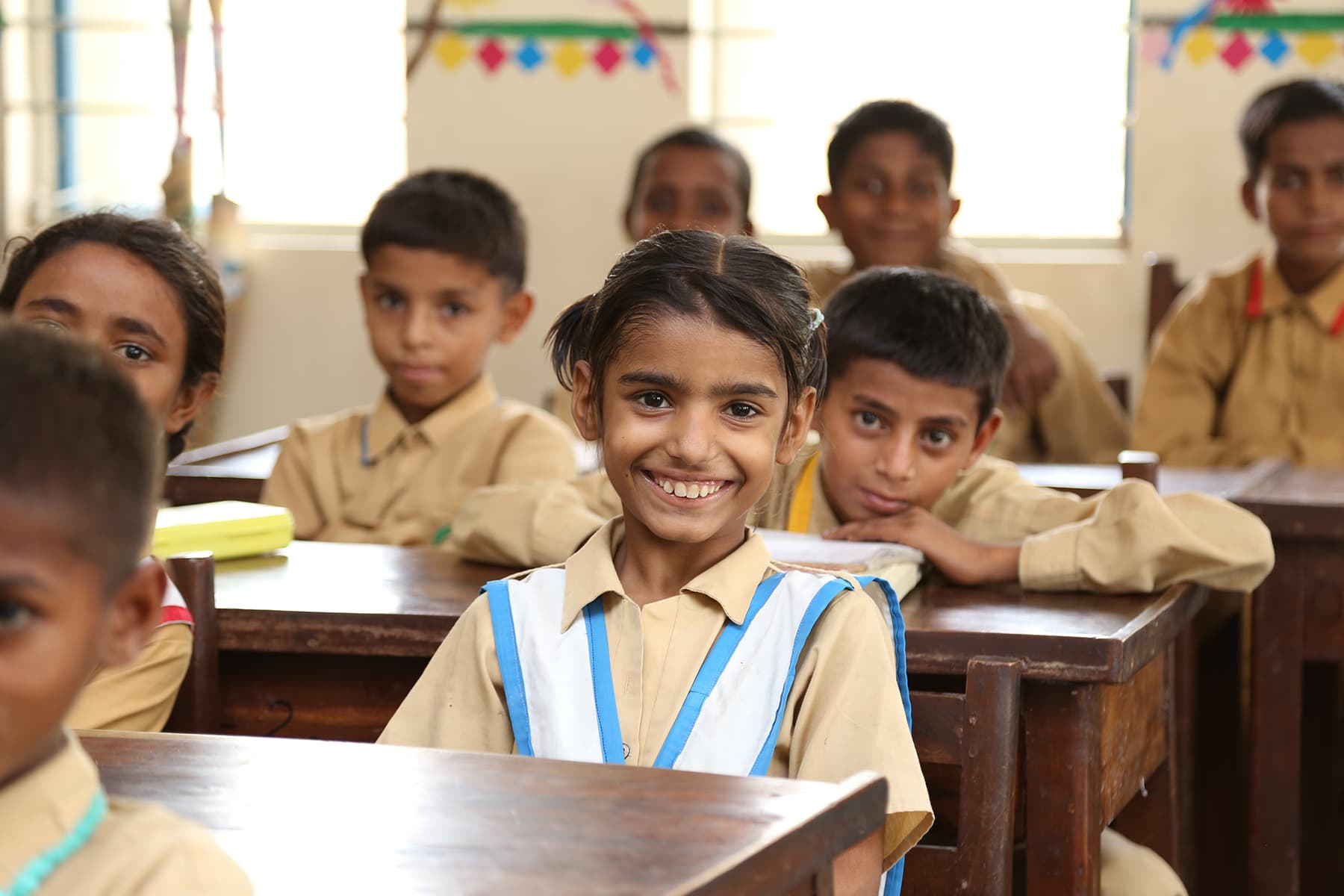 A girl smiles for the camera during a class at the TCF school in Gambat. - Photo by Mustafa Ilyas