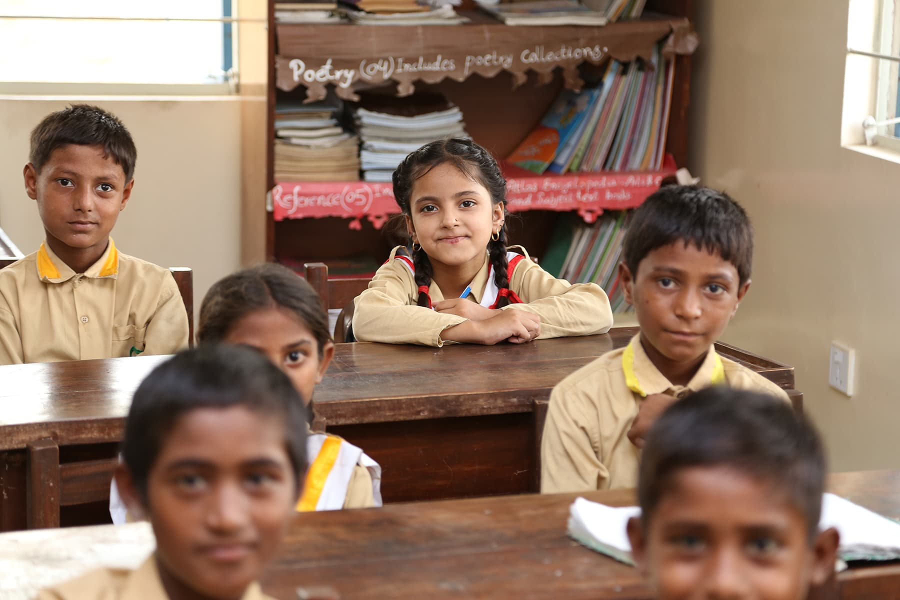 Students look into the camera during a cllass at the TCF Gambat school. - Photo by Mustafa Ilyas