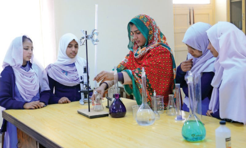 Students attend a chemistry lab class.— Photo by Khurram Amin