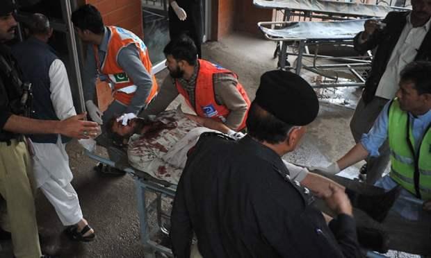 Volunteers move an injured blast victim to hospital. ─ AFP