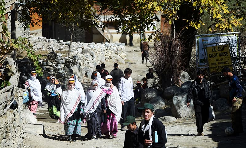 Kalash students return from school in Brun village of the Bumboret valley. — AFP