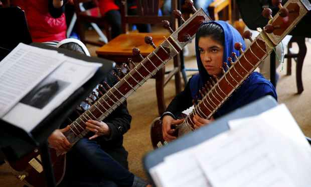 Members of the Zohra orchestra attend a rehearsal. ─ Reuters