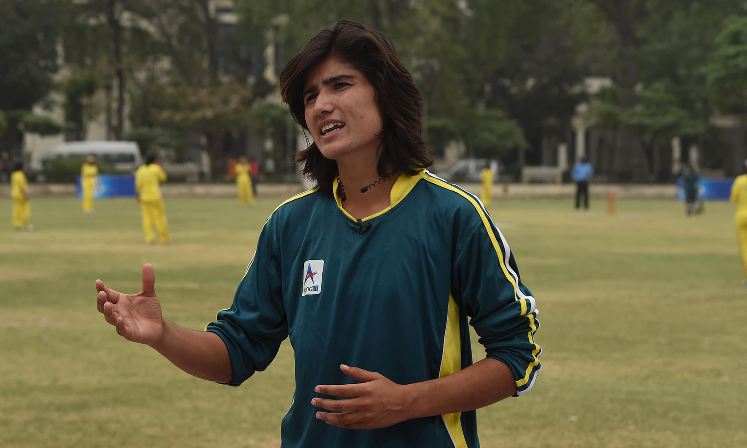 Pakistani national cricket and football player Diana Baig gestures as she speaks during an interview in Lahore. — AFP