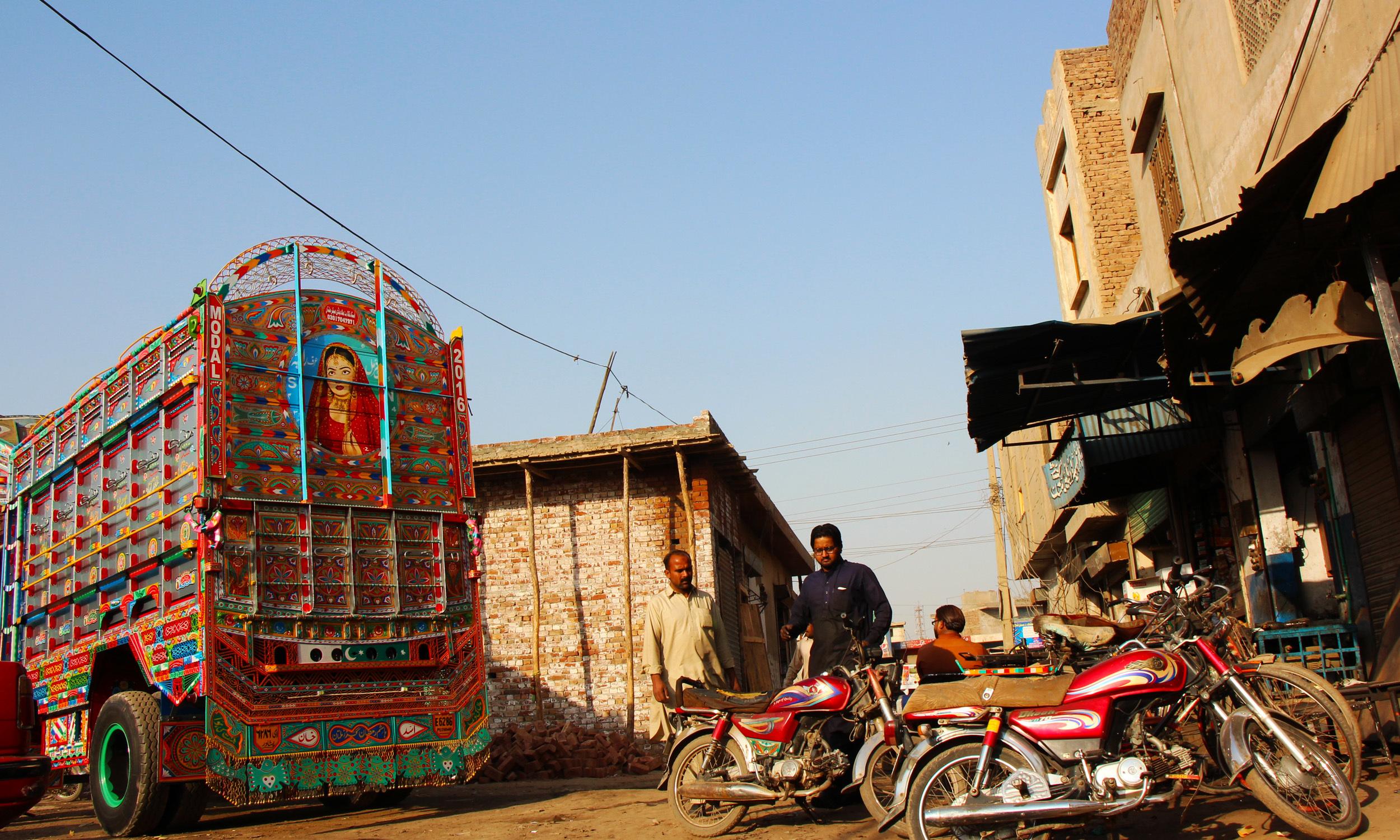 The freshly painted truck stands, Multan