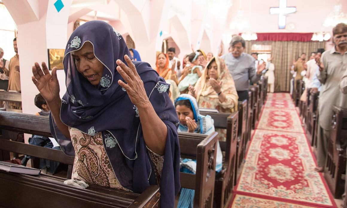 A woman weeps during service at St. Mary's Church in Quetta | Sara Faruqi