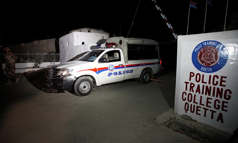 A police vehicle is seen at a gate to the Police Training Center.— Reuters