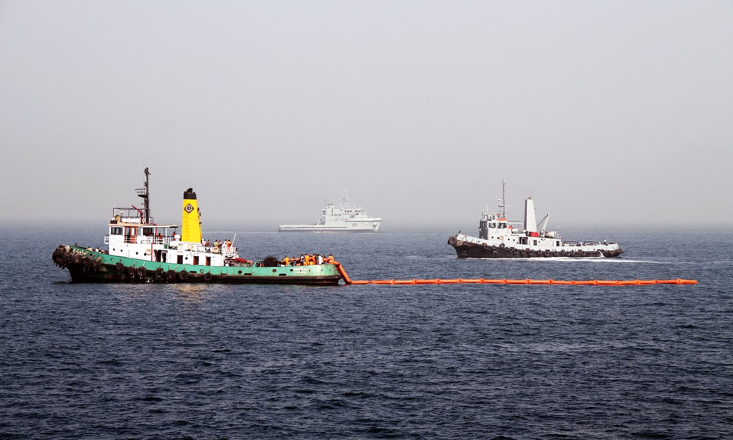 Pakistan Navy and Maritime Security Agency assets deploying oil spill equipment during marine oil containment exercise BARRACUDA-VII at Arabian sea near Karachi. ─Navy PR