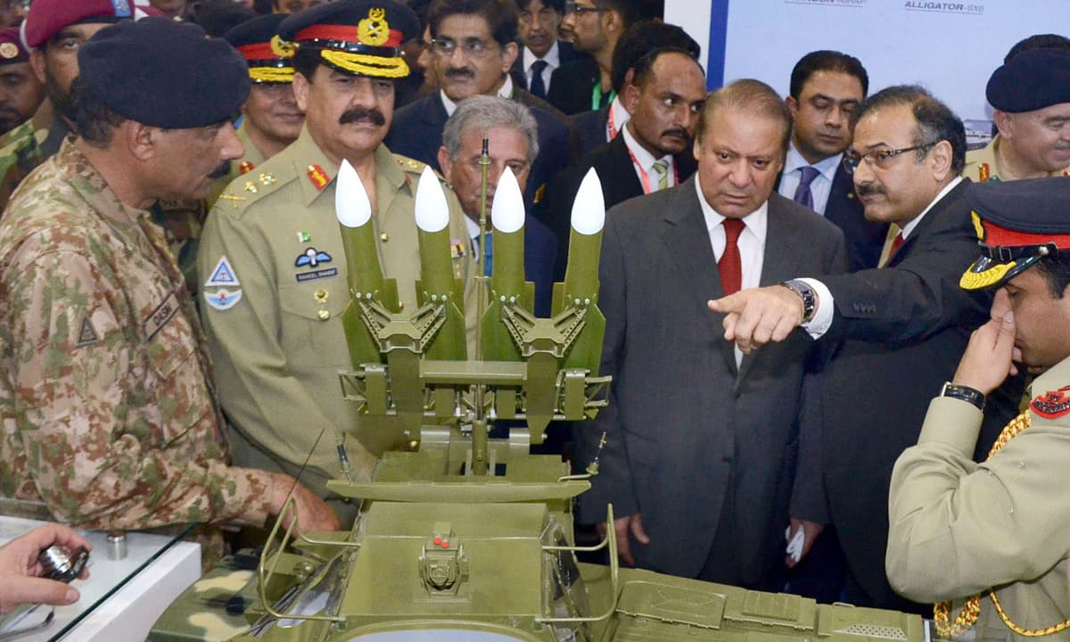 Prime Minister Nawaz Sharif along with Army Chief Gen Raheel Sharif being briefed about displayed stuff during IDEAS-2016. —APP
