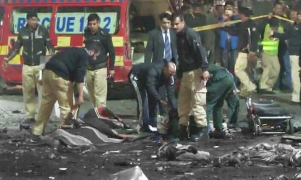 Police personnel at site of attack. -DawnNews