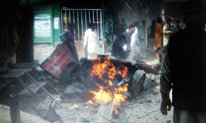 The image shows a gutted car at the blast site.—DawnNews