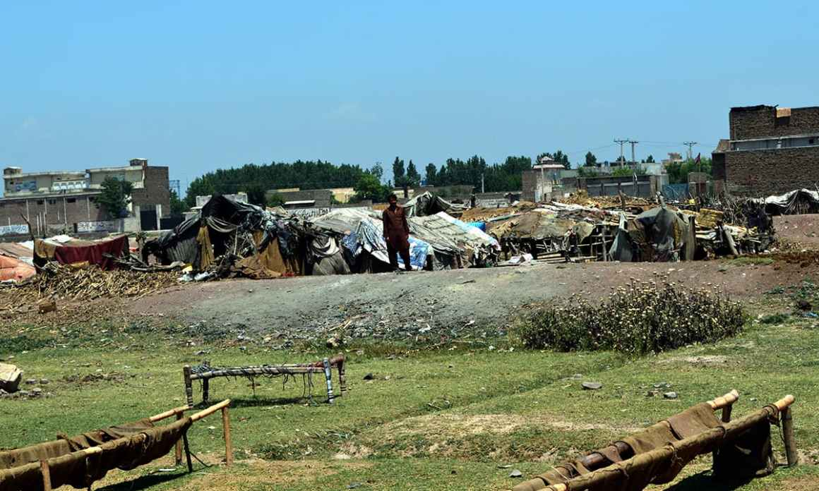 Makeshift houses occupied by nomads near the motorway in Peshawar. Credit: Musharraf Ali