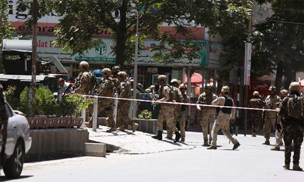 Afghan security forces cordon off the attack site. ─ AP