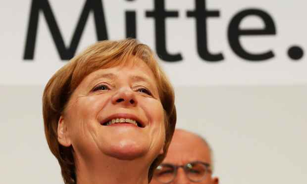 German Chancellor and CDU party leader Angela Merkel addresses supporters after exit poll results were broadcasted on public television at an election night event at the party's headquarters in Berlin during the general election on September 24, 2017. —AFP