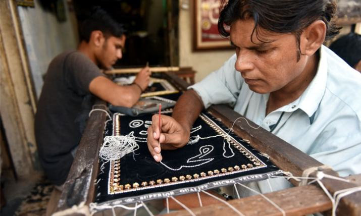 Workers busy preparing alams. For many, this is as much about devotion as it is a labour of love | Faheem Siddiqui /White Star