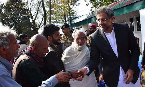 PM Abbasi visits the families of LoC firing victims. ─ Photo courtesy ISPR