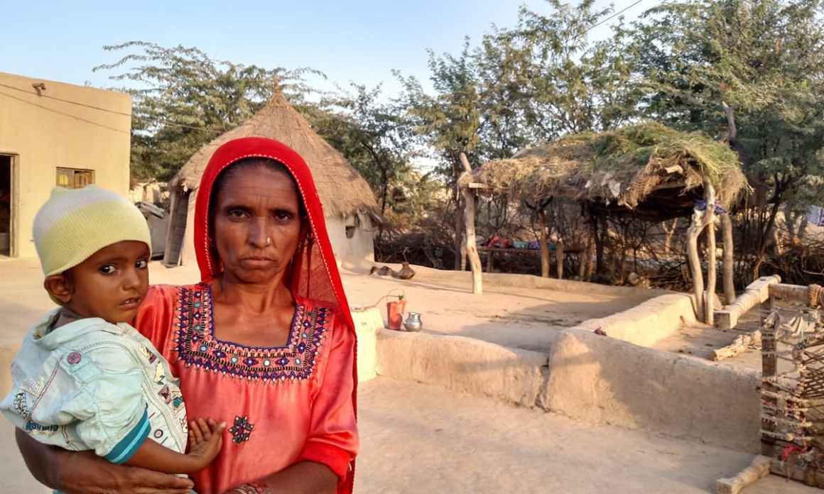 Fatima with her grandson in their home in Kharooro Charan, Umerkot | Credit: Bilal Karim Mughal