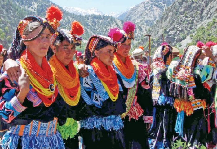 Kalash women dance during the Chilim Jusht festival. — Dawn