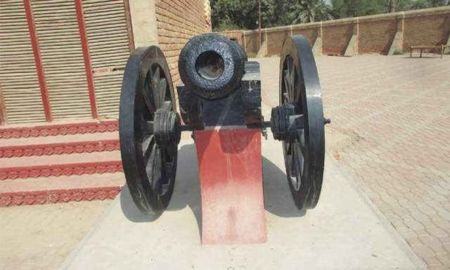 An antique gun mounted within the compound