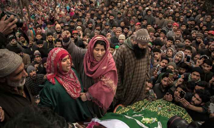 Rayees Ahmad Ganai's mother, Musmaat Fatima (left), and his sister (centre) during his funeral | Photo by Vikar Syed
