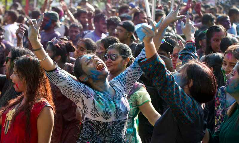Revellers dance as they celebrate Holi, organised by the Hindu community at a park on March 20, 2019, in Yangon, Myanmar. — AP