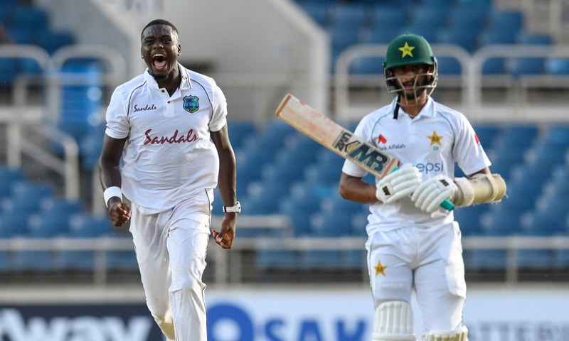 Jayden Seales (L) of West Indies celebrates the dismissal of Hasan Ali (R) of Pakistan during day one of the first Test between West Indies and Pakistan at Sabina Park in Kingston, Jamaica. — AFP