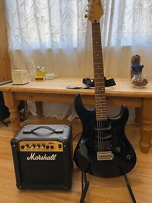 yamaha guitar and marshall amplifier