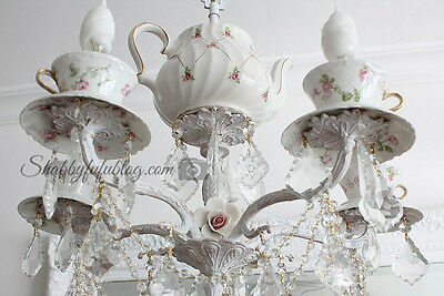 A Vintage Teapot Is The Focal Point Of This Chandelier