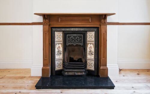 An Edwardian Fireplace with dado rail