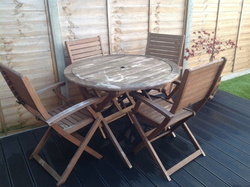 HOMEBASE GARDEN FURNITURE - TABLE AND FOUR CHAIRS