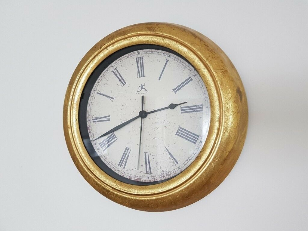 Gold Circular Wall Clock With Roman Numerals And Second
