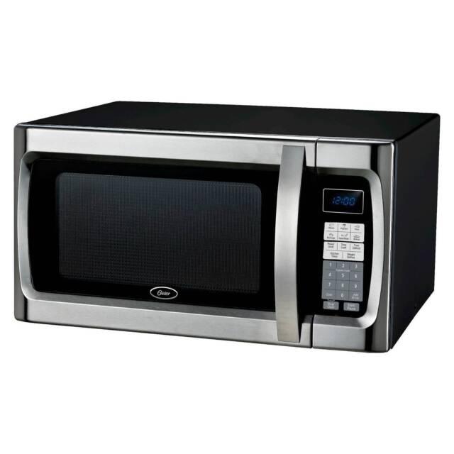 oster 1 3 cu ft 1100 watt microwave oven black ogzf1301