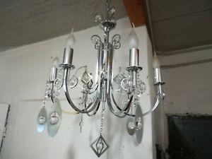 I vetri sono scalpellati , presentano sfaccettature molto belle e di grande effetto.struttura in acciaio. Sciolari Lampadario Modernariato Anni 70 Gocce Cristallo Cromato Vintage Ebay