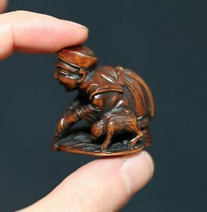 antique Japanese carved Netsuke of a farmer & Puppy, Edo period, 19th Century.