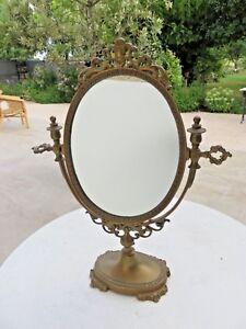 details sur miroir de table a poser en laiton