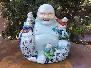 large Chinese porcelain figure of Budai with clinging children