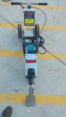 tile and asphalt floor remover demolition hammer on easy hammer cart used