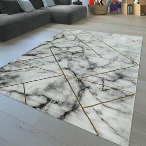 details sur tapis de salon a poils ras design marbre lignes geometriques aspect use en dore