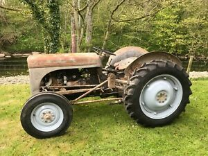 Grey Ferguson Tractor with front loader/, hydraulics, classic farm equipment.