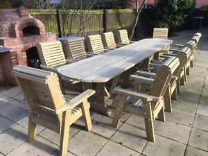 large wooden garden table and chairs