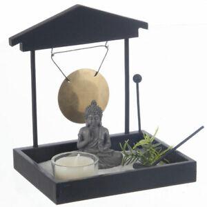 details sur jardin zen japonais bouddha avec sable gong photophore