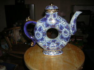 BLUE AND WHITE FLORAL DOUGHNUT SHAPED CHINESE STYLE TEAPOT 25 CM TALL