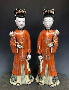 A pair of figurines women statue with mark
