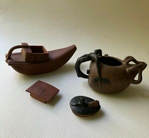 Two Chinese Yixing Pottery Covered Teapots: Boat-form and Gourd-form