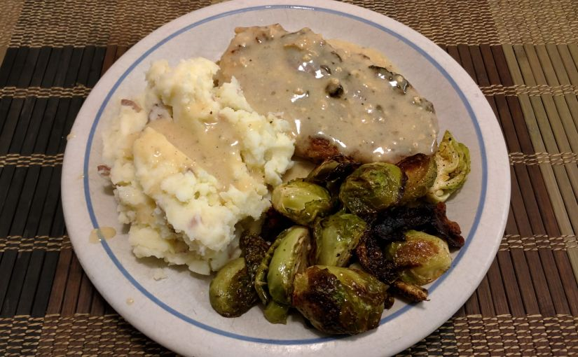 Pork chops, Brussels sprouts, and mashed potatoes