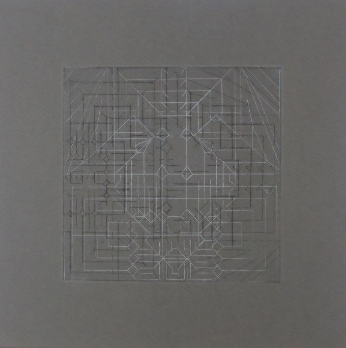 Hand printed geometric etching on gray paper