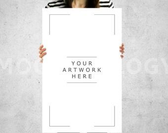 girl holding poster mockup
