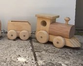 Wooden toy train set with steam locomotive and three carriages, handmade.